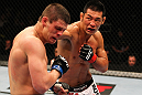 SAITAMA, JAPAN - FEBRUARY 26:  (R-L) RIki Fukuda punches Steve Cantwell during the UFC 144 event at Saitama Super Arena on February 26, 2012 in Saitama, Japan.  (Photo by Al Bello/Zuffa LLC/Zuffa LLC via Getty Images) *** Local Caption *** Riki Fukuda; Steve Cantwell