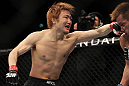 SAITAMA, JAPAN - FEBRUARY 26:  (L-R) Takanori Gomi punches Eiji Mitsuoka during the UFC 144 event at Saitama Super Arena on February 26, 2012 in Saitama, Japan.  (Photo by Josh Hedges/Zuffa LLC/Zuffa LLC via Getty Images) *** Local Caption *** Takanori Gomi; Eiji Mitsuoka