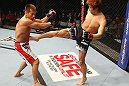 SAITAMA, JAPAN - FEBRUARY 26:  (R-L) Takanori Gomi kicks Eiji Mitsuoka during the UFC 144 event at Saitama Super Arena on February 26, 2012 in Saitama, Japan.  (Photo by Al Bello/Zuffa LLC/Zuffa LLC via Getty Images) *** Local Caption *** Takanori Gomi; Eiji Mitsuoka