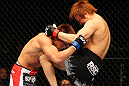 SAITAMA, JAPAN - FEBRUARY 26:  (R-L) Takanori Gomi delivers a knee strike against Eiji Mitsuoka during the UFC 144 event at Saitama Super Arena on February 26, 2012 in Saitama, Japan.  (Photo by Al Bello/Zuffa LLC/Zuffa LLC via Getty Images) *** Local Caption *** Takanori Gomi; Eiji Mitsuoka