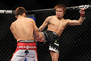 SAITAMA, JAPAN - FEBRUARY 26:  (R-L) Takanori Gomi kicks Eiji Mitsuoka during the UFC 144 event at Saitama Super Arena on February 26, 2012 in Saitama, Japan.  (Photo by Josh Hedges/Zuffa LLC/Zuffa LLC via Getty Images) *** Local Caption *** Takanori Gomi; Eiji Mitsuoka