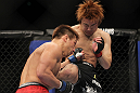 SAITAMA, JAPAN - FEBRUARY 26:  (R-L) Takanori Gomi and Eiji Mitsuoka trade strikes during the UFC 144 event at Saitama Super Arena on February 26, 2012 in Saitama, Japan.  (Photo by Josh Hedges/Zuffa LLC/Zuffa LLC via Getty Images) *** Local Caption *** Takanori Gomi; Eiji Mitsuoka