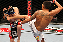 SAITAMA, JAPAN - FEBRUARY 26:  (R-L) Anthony Pettis kicks Joe Lauzon during the UFC 144 event at Saitama Super Arena on February 26, 2012 in Saitama, Japan.  (Photo by Al Bello/Zuffa LLC/Zuffa LLC via Getty Images) *** Local Caption *** Anthony Pettis; Joe Lauzon