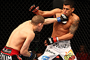 SAITAMA, JAPAN - FEBRUARY 26:  (L-R) Joe Lauzon punches Anthony Pettis during the UFC 144 event at Saitama Super Arena on February 26, 2012 in Saitama, Japan.  (Photo by Al Bello/Zuffa LLC/Zuffa LLC via Getty Images) *** Local Caption *** Anthony Pettis; Joe Lauzon