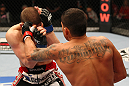 SAITAMA, JAPAN - FEBRUARY 26:  (R-L) Anthony Pettis punches Joe Lauzon during the UFC 144 event at Saitama Super Arena on February 26, 2012 in Saitama, Japan.  (Photo by Al Bello/Zuffa LLC/Zuffa LLC via Getty Images) *** Local Caption *** Anthony Pettis; Joe Lauzon