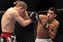 SAITAMA, JAPAN - FEBRUARY 26:  (R-L) Anthony Pettis punches Joe Lauzon during the UFC 144 event at Saitama Super Arena on February 26, 2012 in Saitama, Japan.  (Photo by Josh Hedges/Zuffa LLC/Zuffa LLC via Getty Images) *** Local Caption *** Anthony Pettis; Joe Lauzon