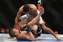 SAITAMA, JAPAN - FEBRUARY 26:  (R-L) Anthony Pettis knocks out Joe Lauzon during the UFC 144 event at Saitama Super Arena on February 26, 2012 in Saitama, Japan.  (Photo by Josh Hedges/Zuffa LLC/Zuffa LLC via Getty Images) *** Local Caption *** Anthony Pettis; Joe Lauzon