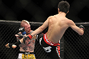 SAITAMA, JAPAN - FEBRUARY 26:  (R-L) Hatsu Hioki kicks Bart Palaszewski during the UFC 144 event at Saitama Super Arena on February 26, 2012 in Saitama, Japan.  (Photo by Josh Hedges/Zuffa LLC/Zuffa LLC via Getty Images) *** Local Caption *** Hatsu Hioki; Bart Palaszewski