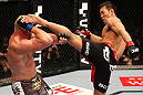 SAITAMA, JAPAN - FEBRUARY 26:  (R-L) Yushin Okami kicks Tim Boetsch during the UFC 144 event at Saitama Super Arena on February 26, 2012 in Saitama, Japan.  (Photo by Al Bello/Zuffa LLC/Zuffa LLC via Getty Images) *** Local Caption *** Yushin Okami; Tim Boetsch