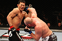 SAITAMA, JAPAN - FEBRUARY 26:  (R-L) Tim Boetsch punches Yushin Okami during the UFC 144 event at Saitama Super Arena on February 26, 2012 in Saitama, Japan.  (Photo by Al Bello/Zuffa LLC/Zuffa LLC via Getty Images) *** Local Caption *** Yushin Okami; Tim Boetsch