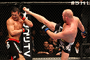 SAITAMA, JAPAN - FEBRUARY 26:  (R-L) Tim Boetsch kicks Yushin Okami during the UFC 144 event at Saitama Super Arena on February 26, 2012 in Saitama, Japan.  (Photo by Al Bello/Zuffa LLC/Zuffa LLC via Getty Images) *** Local Caption *** Yushin Okami; Tim Boetsch