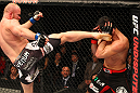 SAITAMA, JAPAN - FEBRUARY 26:  (L-R) Tim Boetsch kicks Yushin Okami during the UFC 144 event at Saitama Super Arena on February 26, 2012 in Saitama, Japan.  (Photo by Al Bello/Zuffa LLC/Zuffa LLC via Getty Images) *** Local Caption *** Yushin Okami; Tim Boetsch