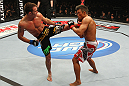 SAITAMA, JAPAN - FEBRUARY 26:  (L-R) Jake Shields kicks Yoshihiro Akiyama during the UFC 144 event at Saitama Super Arena on February 26, 2012 in Saitama, Japan.  (Photo by Al Bello/Zuffa LLC/Zuffa LLC via Getty Images) *** Local Caption *** Yoshihiro Akiyama; Jake Shields