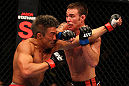 SAITAMA, JAPAN - FEBRUARY 26:  (R-L) Jake Shields punches Yoshihiro Akiyama during the UFC 144 event at Saitama Super Arena on February 26, 2012 in Saitama, Japan.  (Photo by Al Bello/Zuffa LLC/Zuffa LLC via Getty Images) *** Local Caption *** Yoshihiro Akiyama; Jake Shields