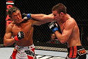 SAITAMA, JAPAN - FEBRUARY 26:  (L-R) Yoshihiro Akiyama and Jake Shields trade punches during the UFC 144 event at Saitama Super Arena on February 26, 2012 in Saitama, Japan.  (Photo by Al Bello/Zuffa LLC/Zuffa LLC via Getty Images) *** Local Caption *** Yoshihiro Akiyama; Jake Shields