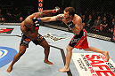 SAITAMA, JAPAN - FEBRUARY 26:  (R-L) Ryan Bader punches Quinton