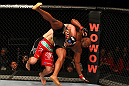 "SAITAMA, JAPAN - FEBRUARY 26:  (L-R) Ryan Bader takes down Quinton ""Rampage"" Jackson during the UFC 144 event at Saitama Super Arena on February 26, 2012 in Saitama, Japan.  (Photo by Al Bello/Zuffa LLC/Zuffa LLC via Getty Images) *** Local Caption *** Quinton Jackson; Ryan Bader"