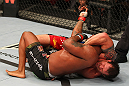 "SAITAMA, JAPAN - FEBRUARY 26:  (R-L) Ryan Bader attempts a guillotine choke against Quinton ""Rampage"" Jackson during the UFC 144 event at Saitama Super Arena on February 26, 2012 in Saitama, Japan.  (Photo by Al Bello/Zuffa LLC/Zuffa LLC via Getty Images) *** Local Caption *** Quinton Jackson; Ryan Bader"