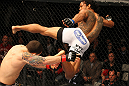 SAITAMA, JAPAN - FEBRUARY 26:  (R-L) Benson Henderson kicks Frankie Edgar during the UFC 144 event at Saitama Super Arena on February 26, 2012 in Saitama, Japan.  (Photo by Al Bello/Zuffa LLC/Zuffa LLC via Getty Images) *** Local Caption *** Frankie Edgar; Benson Henderson