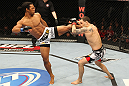 SAITAMA, JAPAN - FEBRUARY 26:  (L-R) Benson Henderson kicks Frankie Edgar during the UFC 144 event at Saitama Super Arena on February 26, 2012 in Saitama, Japan.  (Photo by Al Bello/Zuffa LLC/Zuffa LLC via Getty Images) *** Local Caption *** Frankie Edgar; Benson Henderson