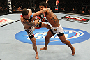 SAITAMA, JAPAN - FEBRUARY 26:  (R-L) Benson Henderson punches Frankie Edgar during the UFC 144 event at Saitama Super Arena on February 26, 2012 in Saitama, Japan.  (Photo by Al Bello/Zuffa LLC/Zuffa LLC via Getty Images) *** Local Caption *** Frankie Edgar; Benson Henderson
