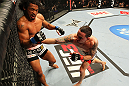 SAITAMA, JAPAN - FEBRUARY 26:  (R-L) Frankie Edgar punches Benson Henderson during the UFC 144 event at Saitama Super Arena on February 26, 2012 in Saitama, Japan.  (Photo by Al Bello/Zuffa LLC/Zuffa LLC via Getty Images) *** Local Caption *** Frankie Edgar; Benson Henderson