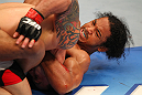 SAITAMA, JAPAN - FEBRUARY 26:  (R-L) Benson Henderson attempts a guillotine choke against Frankie Edgar during the UFC 144 event at Saitama Super Arena on February 26, 2012 in Saitama, Japan.  (Photo by Al Bello/Zuffa LLC/Zuffa LLC via Getty Images) *** Local Caption *** Frankie Edgar; Benson Henderson