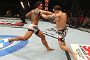 SAITAMA, JAPAN - FEBRUARY 26:  (L-R) Benson Henderson punches Frankie Edgar during the UFC 144 event at Saitama Super Arena on February 26, 2012 in Saitama, Japan.  (Photo by Al Bello/Zuffa LLC/Zuffa LLC via Getty Images) *** Local Caption *** Frankie Edgar; Benson Henderson