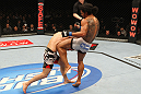 SAITAMA, JAPAN - FEBRUARY 26:  (R-L) Benson Henderson delivers a knee strike against Frankie Edgar during the UFC 144 event at Saitama Super Arena on February 26, 2012 in Saitama, Japan.  (Photo by Al Bello/Zuffa LLC/Zuffa LLC via Getty Images) *** Local Caption *** Frankie Edgar; Benson Henderson