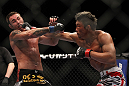 SAITAMA, JAPAN - FEBRUARY 26:  (R-L) Yoshihiro Akiyama punches Jake Shields during the UFC 144 event at Saitama Super Arena on February 26, 2012 in Saitama, Japan.  (Photo by Josh Hedges/Zuffa LLC/Zuffa LLC via Getty Images) *** Local Caption *** Yoshihiro Akiyama; Jake Shields
