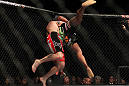 "SAITAMA, JAPAN - FEBRUARY 26:  (L-R) Ryan Bader takes down Quinton ""Rampage"" Jackson during the UFC 144 event at Saitama Super Arena on February 26, 2012 in Saitama, Japan.  (Photo by Josh Hedges/Zuffa LLC/Zuffa LLC via Getty Images) *** Local Caption *** Quinton Jackson; Ryan Bader"
