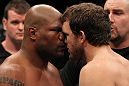 "SAITAMA, JAPAN - FEBRUARY 26:  (L-R) Opponents Quinton ""Rampage"" Jackson and Ryan Bader receive final instructions from the referee before their bout during the UFC 144 event at Saitama Super Arena on February 26, 2012 in Saitama, Japan.  (Photo by Josh Hedges/Zuffa LLC/Zuffa LLC via Getty Images) *** Local Caption *** Quinton Jackson; Ryan Bader"