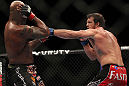 "SAITAMA, JAPAN - FEBRUARY 26:  (R-L) Ryan Bader punches Quinton ""Rampage"" Jackson during the UFC 144 event at Saitama Super Arena on February 26, 2012 in Saitama, Japan.  (Photo by Josh Hedges/Zuffa LLC/Zuffa LLC via Getty Images) *** Local Caption *** Quinton Jackson; Ryan Bader"