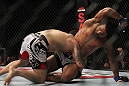 SAITAMA, JAPAN - FEBRUARY 26:  (R-L) Benson Henderson delivers an elbow strike against Frankie Edgar during the UFC 144 event at Saitama Super Arena on February 26, 2012 in Saitama, Japan.  (Photo by Josh Hedges/Zuffa LLC/Zuffa LLC via Getty Images) *** Local Caption *** Frankie Edgar; Benson Henderson