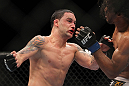 SAITAMA, JAPAN - FEBRUARY 26:  (L-R) Frankie Edgar punches Benson Henderson during the UFC 144 event at Saitama Super Arena on February 26, 2012 in Saitama, Japan.  (Photo by Josh Hedges/Zuffa LLC/Zuffa LLC via Getty Images) *** Local Caption *** Frankie Edgar; Benson Henderson