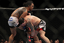 SAITAMA, JAPAN - FEBRUARY 26:  (R-L) Frankie Edgar attempts to take down Benson Henderson during the UFC 144 event at Saitama Super Arena on February 26, 2012 in Saitama, Japan.  (Photo by Josh Hedges/Zuffa LLC/Zuffa LLC via Getty Images) *** Local Caption *** Frankie Edgar; Benson Henderson