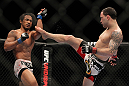SAITAMA, JAPAN - FEBRUARY 26:  (R-L) Frankie Edgar kicks Benson Henderson during the UFC 144 event at Saitama Super Arena on February 26, 2012 in Saitama, Japan.  (Photo by Josh Hedges/Zuffa LLC/Zuffa LLC via Getty Images) *** Local Caption *** Frankie Edgar; Benson Henderson