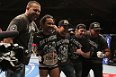 SAITAMA, JAPAN - FEBRUARY 26:  Benson Henderson (second from left) poses for a photo with his team after defeating Frankie Edgar to win the UFC Lightweight Championship during the UFC 144 event at Saitama Super Arena on February 26, 2012 in Saitama, Japan.  (Photo by Josh Hedges/Zuffa LLC/Zuffa LLC via Getty Images) *** Local Caption *** Benson Henderson