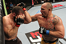 SYDNEY, AUSTRALIA - MARCH 03:  (R-L) Shawn Jordan punches Oli Thompson in their heavyweight bout during the UFC on FX event at Allphones Arena on March 3, 2012 in Sydney, Australia.  (Photo by Josh Hedges/Zuffa LLC/Zuffa LLC via Getty Images) *** Local Caption *** Oli Thompson; Shawn Jordan