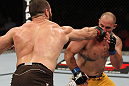SYDNEY, AUSTRALIA - MARCH 03:  (L-R) Oli Thompson punches Shawn Jordan in a heavyweight bout during the UFC on FX event at Allphones Arena on March 3, 2012 in Sydney, Australia.  (Photo by Josh Hedges/Zuffa LLC/Zuffa LLC via Getty Images) *** Local Caption *** Oli Thompson; Shawn Jordan