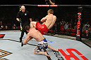 SYDNEY, AUSTRALIA - MARCH 03:  (R-L) TJ Waldburger secures an arm bar submission against Jake Hecht in their welterweight bout during the UFC on FX event at Allphones Arena on March 3, 2012 in Sydney, Australia.  (Photo by Josh Hedges/Zuffa LLC/Zuffa LLC via Getty Images) *** Local Caption *** TJ Waldburger; Jake Hecht