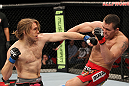 SYDNEY, AUSTRALIA - MARCH 03:  (L-R) Andrew Craig punches Kyle Noke during a middleweight bout during the UFC on FX event at Allphones Arena on March 3, 2012 in Sydney, Australia.  (Photo by Josh Hedges/Zuffa LLC/Zuffa LLC via Getty Images) *** Local Caption *** Kyle Noke; Andrew Craig