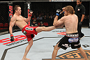 SYDNEY, AUSTRALIA - MARCH 03:  (L-R) Kyle Noke kicks Andrew Craig in their middleweight bout during the UFC on FX event at Allphones Arena on March 3, 2012 in Sydney, Australia.  (Photo by Josh Hedges/Zuffa LLC/Zuffa LLC via Getty Images) *** Local Caption *** Kyle Noke; Andrew Craig