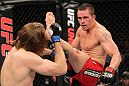 SYDNEY, AUSTRALIA - MARCH 03:  (R-L) Kyle Noke kicks Andrew Craig in their middleweight bout during the UFC on FX event at Allphones Arena on March 3, 2012 in Sydney, Australia.  (Photo by Josh Hedges/Zuffa LLC/Zuffa LLC via Getty Images) *** Local Caption *** Kyle Noke; Andrew Craig