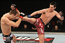 SYDNEY, AUSTRALIA - MARCH 03:  (R-L) Steven Siler kicks Cole Miller in a featherweight bout during the UFC on FX event at Allphones Arena on March 3, 2012 in Sydney, Australia.  (Photo by Josh Hedges/Zuffa LLC/Zuffa LLC via Getty Images) *** Local Caption *** Cole Miller; Steven Siler