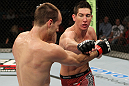 SYDNEY, AUSTRALIA - MARCH 03:  (R-L) Steven Siler punches Cole Miller in a featherweight bout during the UFC on FX event at Allphones Arena on March 3, 2012 in Sydney, Australia.  (Photo by Josh Hedges/Zuffa LLC/Zuffa LLC via Getty Images) *** Local Caption *** Cole Miller; Steven Siler