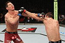 SYDNEY, AUSTRALIA - MARCH 03:  (R-L) Cole Miller punches Steven Siler in a featherweight bout during the UFC on FX event at Allphones Arena on March 3, 2012 in Sydney, Australia.  (Photo by Josh Hedges/Zuffa LLC/Zuffa LLC via Getty Images) *** Local Caption *** Cole Miller; Steven Siler