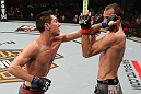 SYDNEY, AUSTRALIA - MARCH 03:  (L-R) Steven Siler punches Cole Miller in a featherweight bout during the UFC on FX event at Allphones Arena on March 3, 2012 in Sydney, Australia.  (Photo by Josh Hedges/Zuffa LLC/Zuffa LLC via Getty Images) *** Local Caption *** Cole Miller; Steven Siler