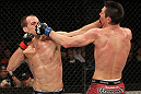 SYDNEY, AUSTRALIA - MARCH 03:  (R-L) Steven Siler and Cole Miller trade punches in a featherweight bout during the UFC on FX event at Allphones Arena on March 3, 2012 in Sydney, Australia.  (Photo by Josh Hedges/Zuffa LLC/Zuffa LLC via Getty Images) *** Local Caption *** Cole Miller; Steven Siler