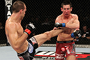 SYDNEY, AUSTRALIA - MARCH 03:  (L-R) Cole Miller kicks Steven Siler in a featherweight bout during the UFC on FX event at Allphones Arena on March 3, 2012 in Sydney, Australia.  (Photo by Josh Hedges/Zuffa LLC/Zuffa LLC via Getty Images) *** Local Caption *** Cole Miller; Steven Siler